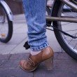 Woman Wearing Brown Shoe With Bicycle — Stock Photo #21930437