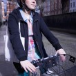Woman Riding Bicycle On Street — Stockfoto