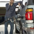 Stock Photo: MPumping Gas Into Car