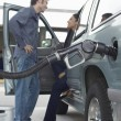 Couple Pumping Gas Into Car — Stock Photo