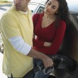 Couple Pumping Gas Into Car — Stock Photo #21937509