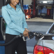 Stock Photo: BusinesswomRefueling Car