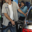 Petrol Station Worker Refueling Car — Stock Photo #21937545