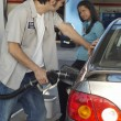 Stock Photo: Worker Refueling Car