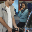 Stock Photo: Petrol Station Worker Refueling Car