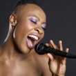 Close-up of African American woman singing — Stock Photo