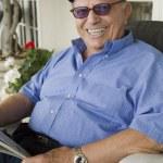 Elderly Man With Newspaper — Stock Photo