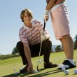 Royalty-Free Stock Photo: Man Teaching Woman To Play Golf