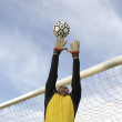 Stock Photo: Goalkeeper Jumping To Catch Ball