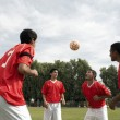 Stock Photo: Footballers Heading Ball