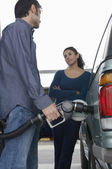 Couple Pumping Gas Into Car — Stock Photo