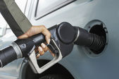 Woman Pumping Gas In Car — Stock Photo