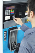 Man Paying With Credit Card At Fuel Pump — Stock Photo