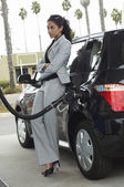 Businesswoman Refueling Car At Station — Stock Photo