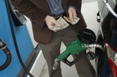 Man Counting Money At Fuel Station — Stock Photo