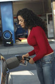 Woman Pumping Gas Into Car — Stock Photo