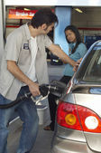 Worker Refueling Car — Stock Photo