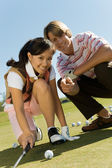 Young Man And Woman On Golf Course — Stock Photo