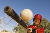 Female Baseball Player Hitting A Shot — Stock Photo