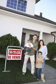 Family Standing In Front Of House For Sale — Stock Photo