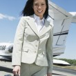 Happy BusinesswomWalking On Airfield — Stock Photo #21940387
