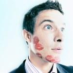 Businessman Lipstick Kiss Marks Over Face — Stock Photo