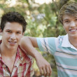 Young Male Friends Smiling - Stockfoto