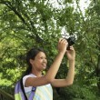 Stock Photo: Happy Teenage Girl Photographing Nature