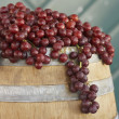 Red Grapes On Barrel - Stock Photo