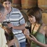 Tasting Wine Beside Wine Casks — Stock Photo