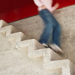 Man Running Down Stairs - Stock Photo