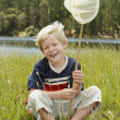 Stock Photo: Boy Sitting Butterfly Net