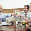 Stock Photo: Businesspeople Toasting Drinks