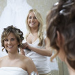 Royalty-Free Stock Photo: Woman Dressing Bride\'s Hair
