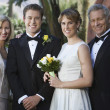 Newly Married Couple Standing With Parents - Stockfoto
