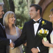 Parents Congratulating Newlywed Couple - Stock Photo