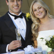 Happy Couple With Wedding Presents - Stockfoto