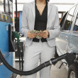 Woman Counting Money At Fuel Station — Stock Photo #21945039