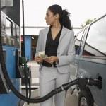 Woman Refuelling Car At Petrol Pump — Stock Photo #21945045