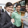 Multiethnic Businesspeople In Library — Stock Photo #21946449