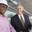 Businessman And Architect Standing With Blueprint — Stock Photo