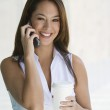Businesswoman On Call Holding Takeout Coffee — Stock Photo