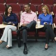 Business People Sitting In Auditorium - Stockfoto