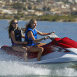 Stock Photo: Women Riding PWC