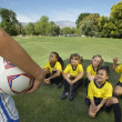 Стоковое фото: Coach In Front Of Girl Soccer Players