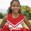 Girl Cheerleader On Soccer Field — Stock Photo #21947575