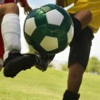 Football Player Tackling Soccer Ball — Stok Fotoğraf #21947639