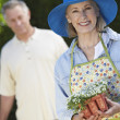 Happy Senior Woman Holding Flower Pot — Stock Photo