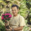 Man Holding Potted Plant In Garden — Stock Photo