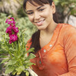 Young Woman Holding Flower Plant — Stock Photo